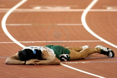 684737-a-runner-is-beaten-and-lays-on-the-track-tired-and-sad-with-defeat